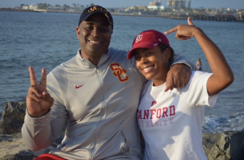 Former USC and NBA player Harold Miner with his daughter Kami, a Stanford-bound senior volleyball player at Redondo Union.
