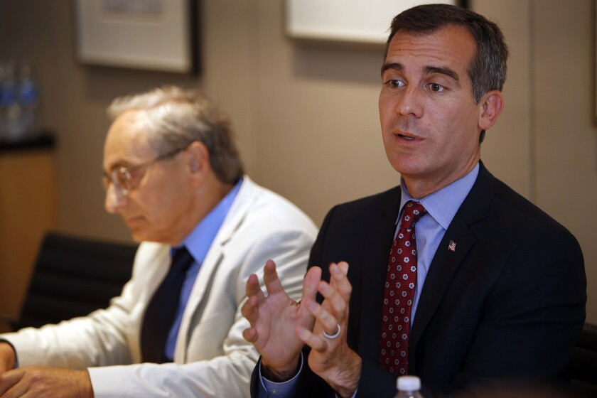 Los Angeles Mayor Eric Garcetti, right, with Michael Reich, professor of economics and director of the Institute for Research on Labor and Employment at UC Berkeley, meets with the Los Angeles Times Editorial Board.
