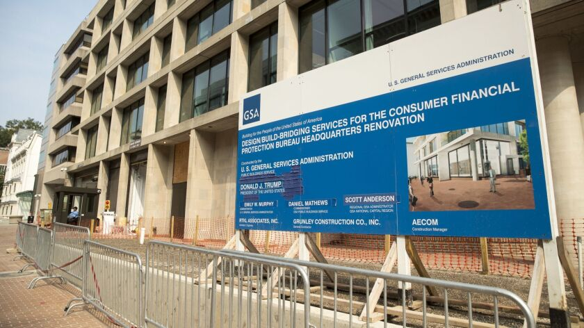 A sign stands at the construction site for the Consumer Financial Protection Bureau's new headquarte