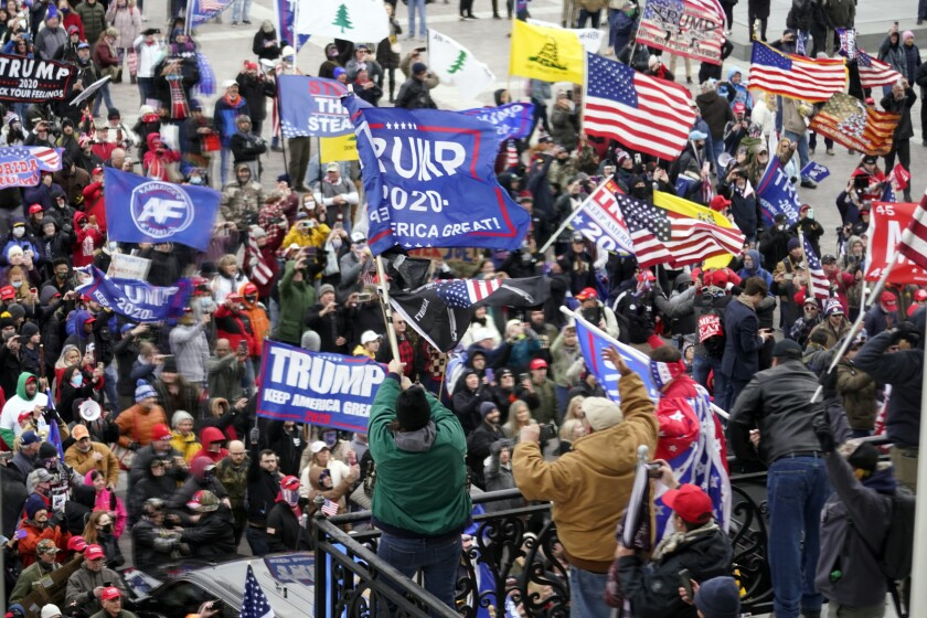 Trump supporters gather and wave banners and flags at the Capitol on Wednesday.
