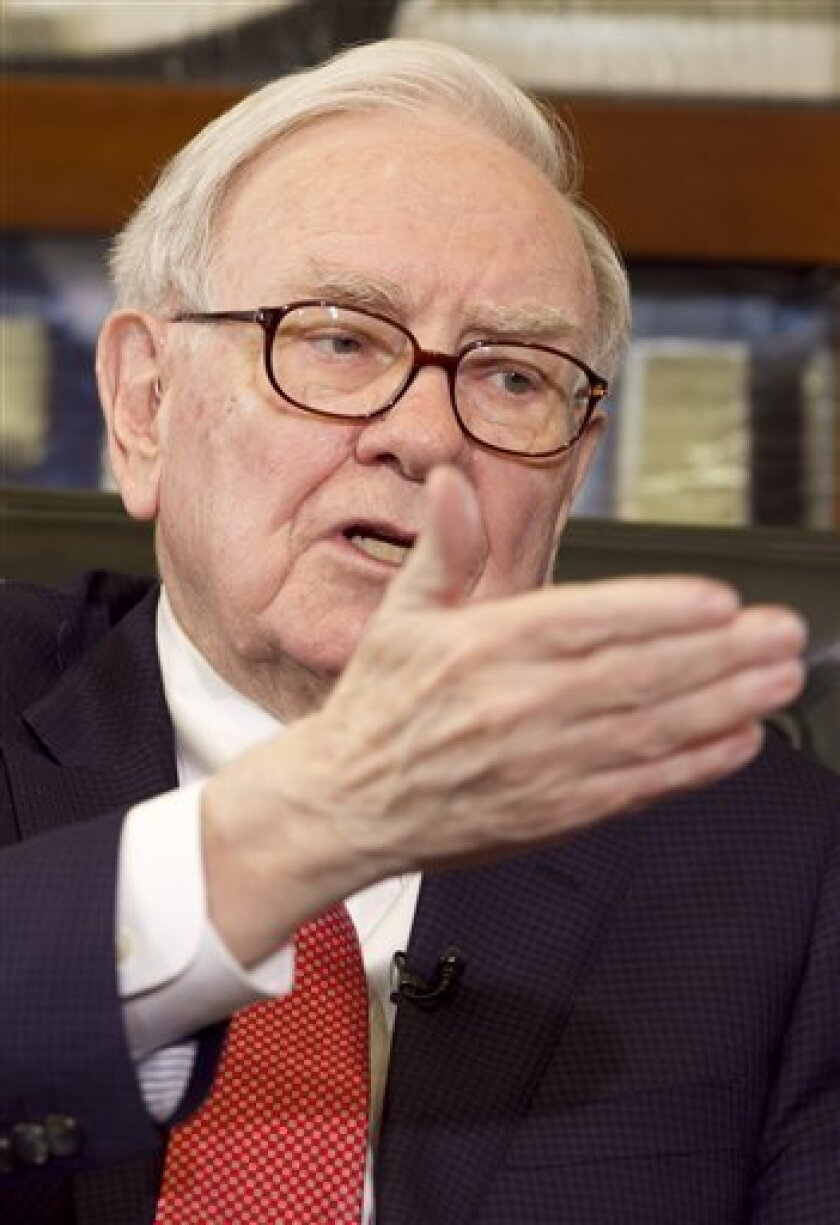 FILE - In this May 2, 2011 file photo, Warren Buffett, Chairman and CEO of Berkshire Hathaway, gestures during an interview on the Fox Business Network with Liz Claman, in Omaha, Neb. Buffett said Thursday, July 7, 2011, Congress is playing a dangerous game by considering not raising the U.S. debt ceiling.(AP Photo/Nati Harnik, file)