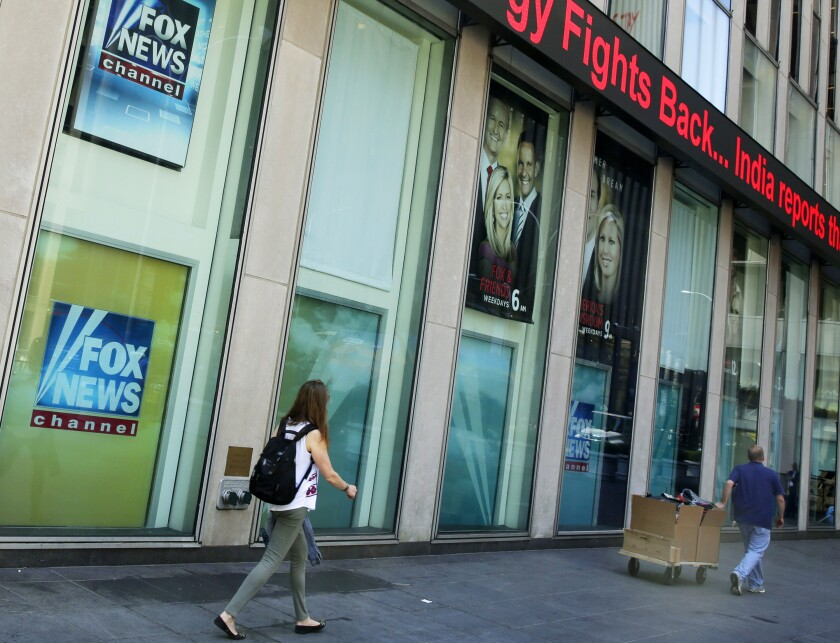 Pedestrians outside News Corp. headquarters and Fox News studios in New York