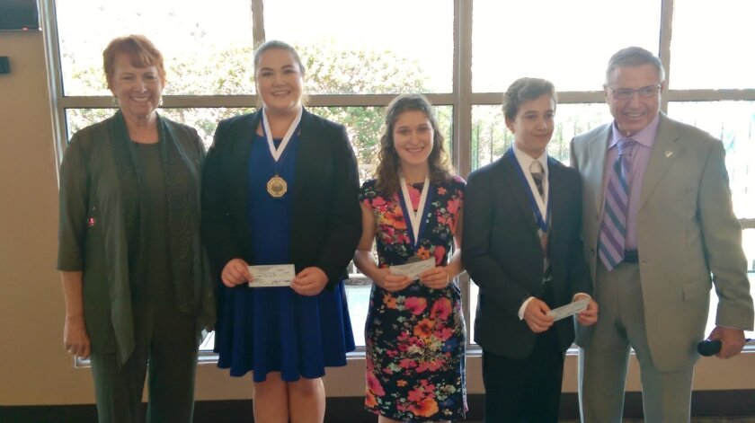 Oratorical Contest Co-Chairs, Suzie Murphy (left) and John Murphy (far right) flank contest winners Briana Kaler, Rachel Dovsky, and Daniel Kalotov shown with their medallions and contest award checks.
