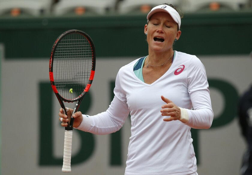 Australia's Samantha Stosur reacts as she plays  Spain's Garbine Muguruza during their semifinal match of the French Open tennis tournament at the Roland Garros stadium, Friday, June 3, 2016 in Paris. (AP Photo/Michel Euler)