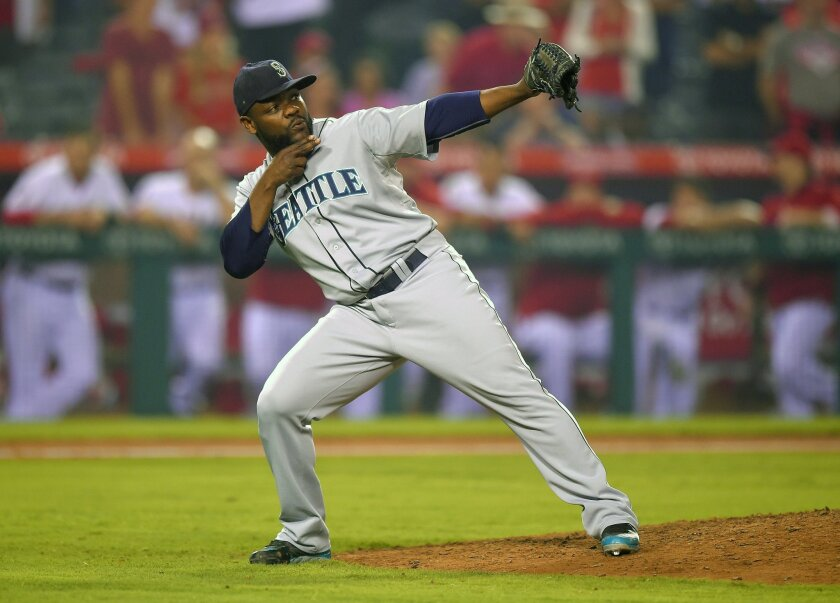 Seattle Mariners relief pitcher Fernando Rodney gestures after they defeated the Los Angeles Angels 3-1 in a baseball game, Thursday Sept. 18, 2014, in Anaheim, Calif. (AP Photo/Mark J. Terrill)