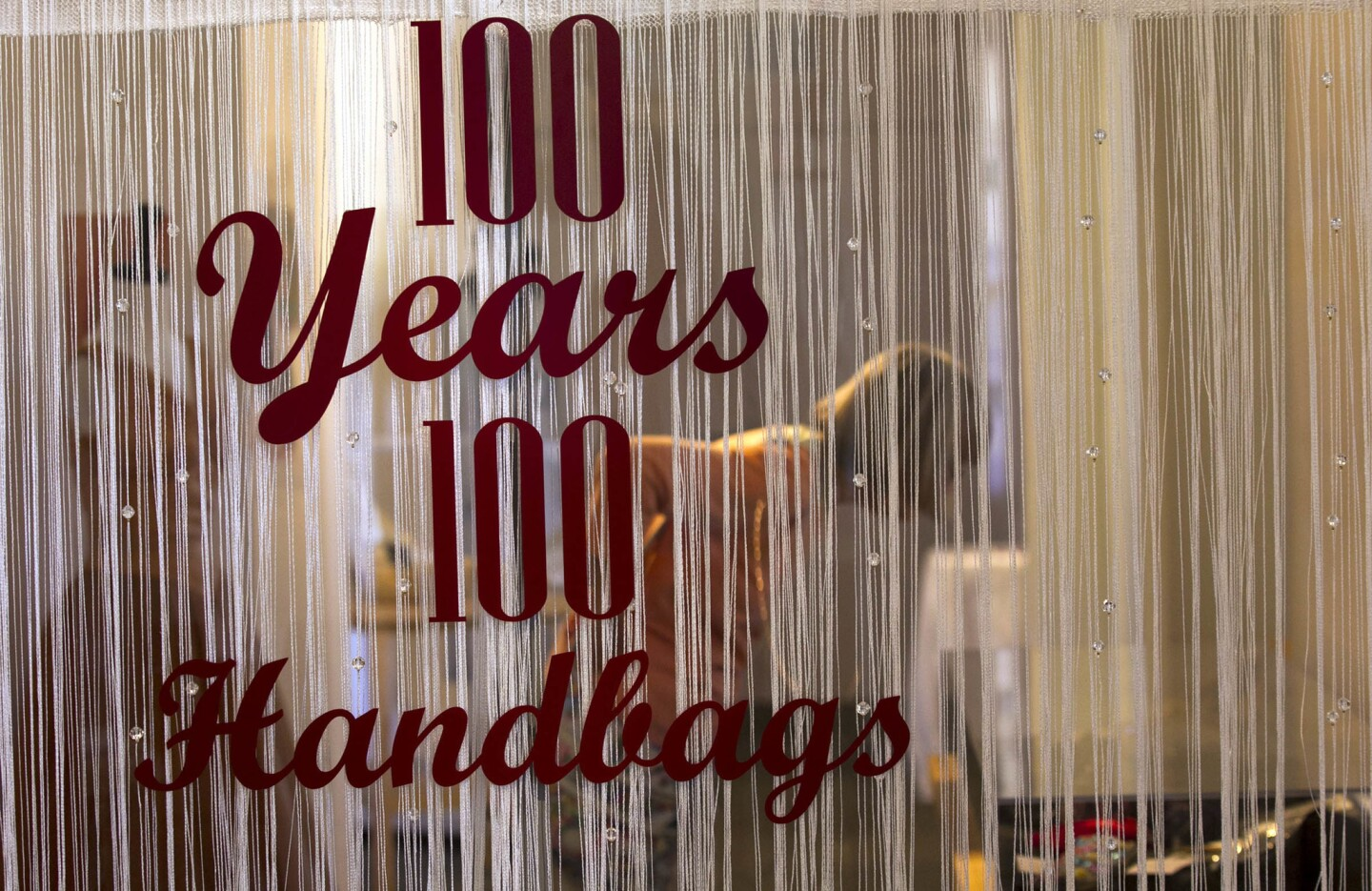 """Entrance to the exhibit at the Women's Museum of California at Liberty Station, """"100 years, 100 Handbags."""""""