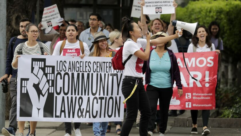 Members of a coalition of legal advocates, community organizations and tenants fighting for rent stabilization and fair housing practices marched to the Board of Supervisors meeting ahead of a vote Tuesday on a measure to cap rent increases in unincorporated areas of L.A. County.