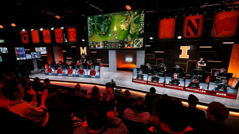 "The audience watches a match between the University of Maryland, left, and the University of Illinois in the Big Ten Network ""League of Legends"" championship."