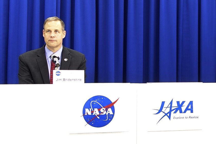 NASA administrator Jim Bridenstine attends a press conference at the Japan Aerospace Exploration Agency (JAXA) headquarters in Tokyo Wednesday, Sept. 25, 2019. Bridenstine said space security is necessary so that the United States, Japan and other allies can safely explore the moon and Mars explorations. Bridenstine said NASA said that gadgets using the space technology have become indispensable part of the people's lives and its safety must be preserved. (AP Photo/Mari Yamaguchi)