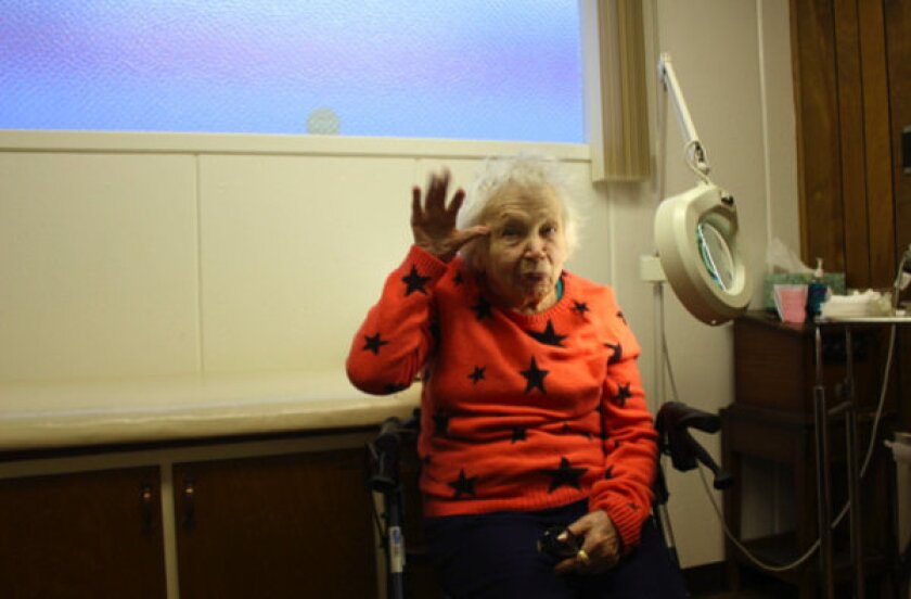 """Barbara """"Cutie"""" Cooper, 96, author of """"Fall in Love for Life,"""" getting a checkup."""