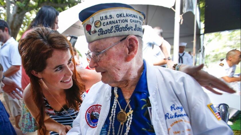 Nikki Brown talks to Pearl Harbor survivor Ray Richmond, 97, of Serra Mesa during a visit to Navy Hale Keiki Elementary School in Pearl Harbor, where he and other World War II veterans who survived the Japanese attack on Dec. 7, 1941, shared their stories.