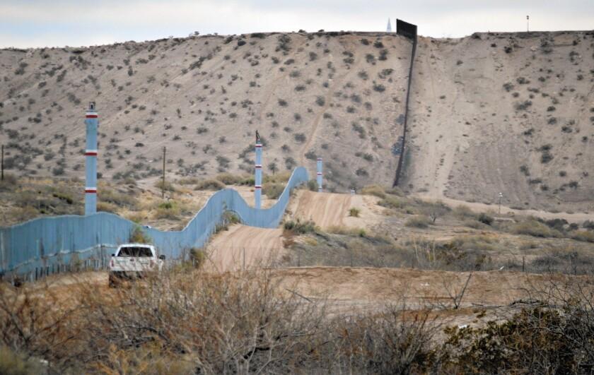 A U.S. Border Patrol agent drives near the U.S.-Mexico border fence in Sunland Park, N.M.