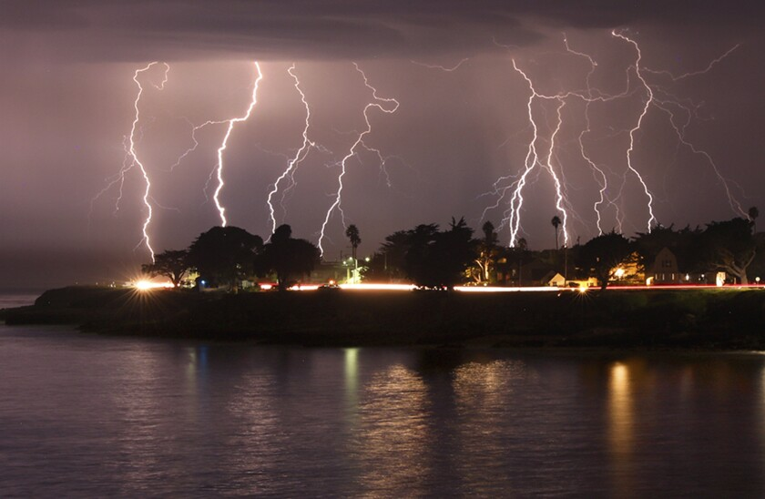 A rare lightning storm crackles over Mitchell's Cove in Santa Cruz.