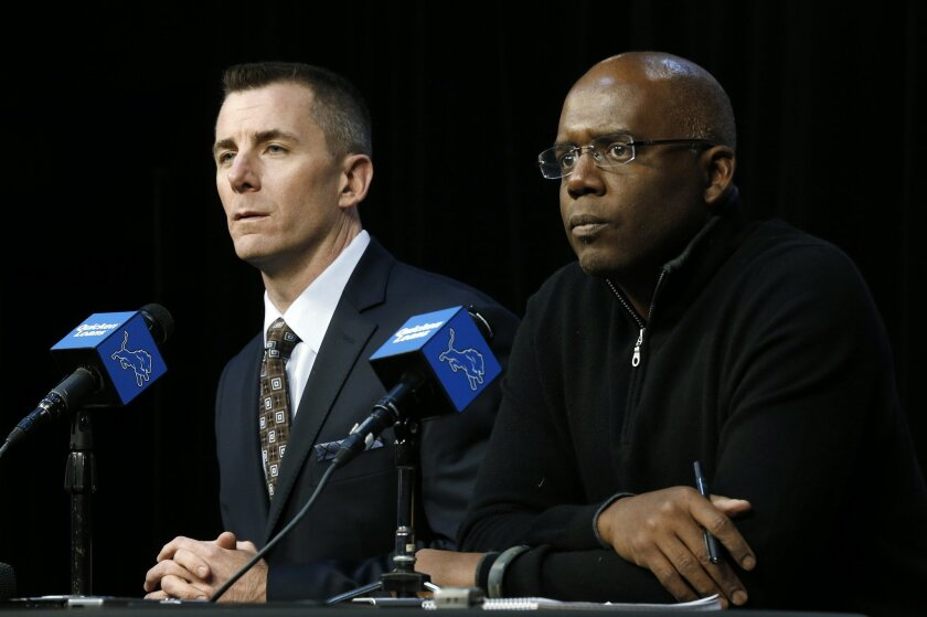 FILE - In this Dec. 30, 2013, file photo, Detroit Lions president Tom Lewand, left, and general manager Martin Mayhew announce head coach Jim Schwartz was fired in Allen Park, Mich. The Lions fired Lewand and Mayhew Thursday, Nov. 5, 2015. Lewand was in his 20th season with the Lions, and his sixth