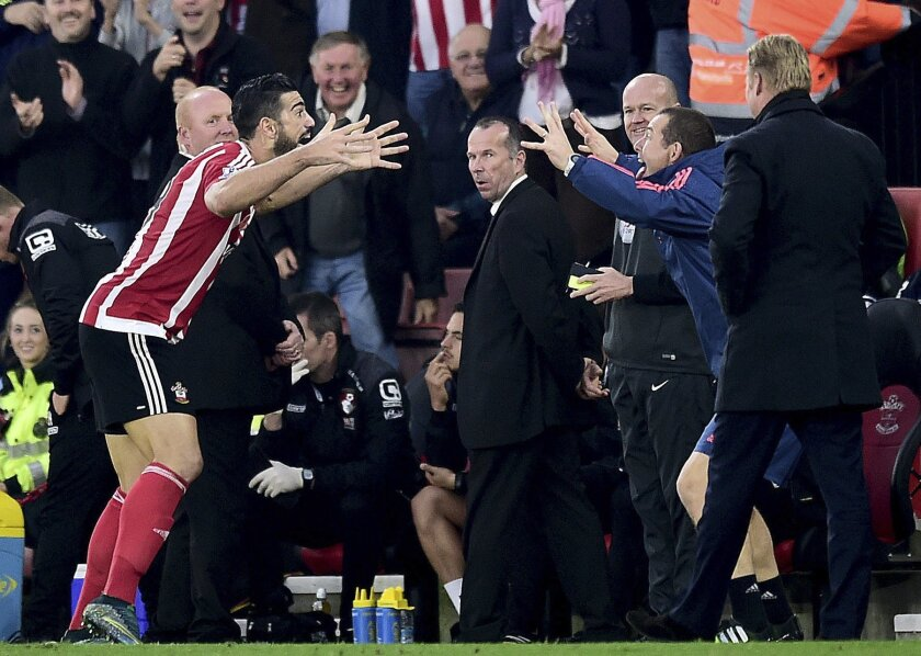 Southampton's Graziano Pelle, left, celebrates scoring his side's second goal of the game  during their English Premier League soccer match against AFC Bournemouth at St Mary's, Southampton, England, Sunday, Nov. 1, 2015. (Adam Davy/PA via AP)      UNITED KINGDOM OUT     -     NO SALES      -    NO
