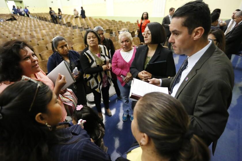 Antonio Plascencia talks to parents
