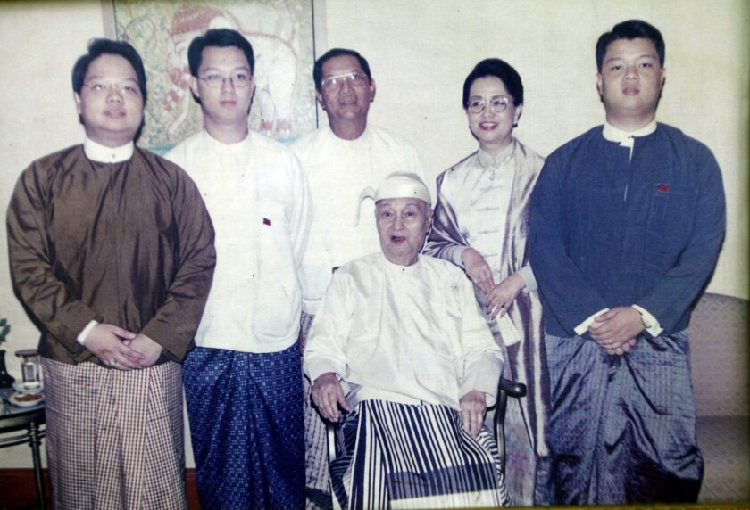 In this 2001 family photo courtesy of former Myanmar military dictator Gen. Ne Win's family,  Gen. Ne Win sits on a chair with his daughter Sanda Win, second from right, his son-in-law Aye Zaw Win, third from left, and his three grandchildren Aye Ne Win, left, Kyaw Ne Win, second from left, and Zwe