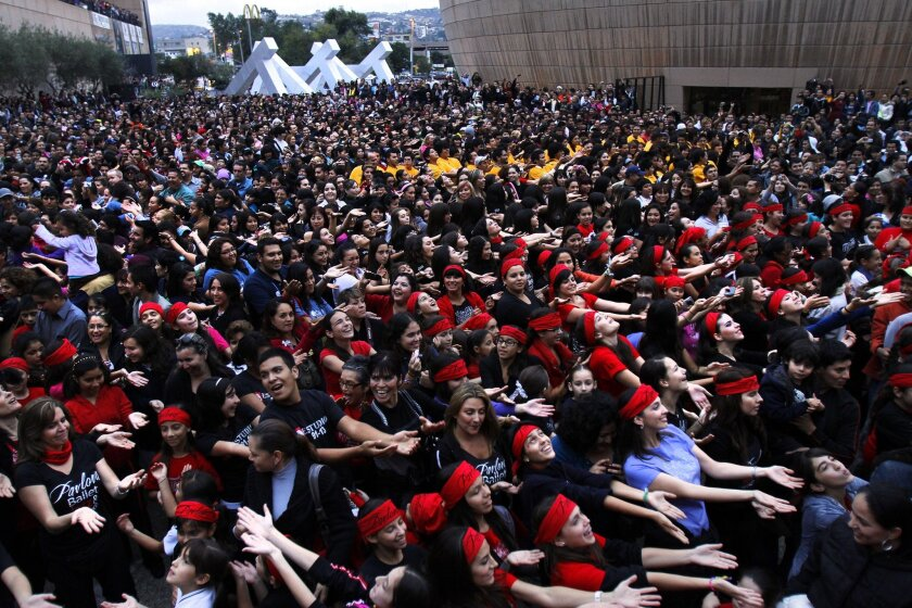 Thousands of people dance outside Tijuana's Cultural Center in a performance at the closing of Tijuana Innovadora in 2010.