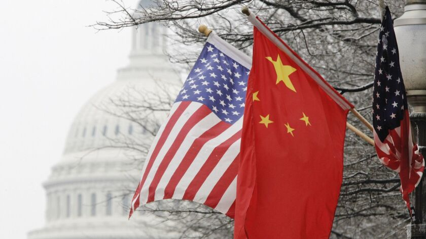 U.S. and Chinese flags in Washington. President Trump's tariff order on Chinese goods sent markets plummeting.