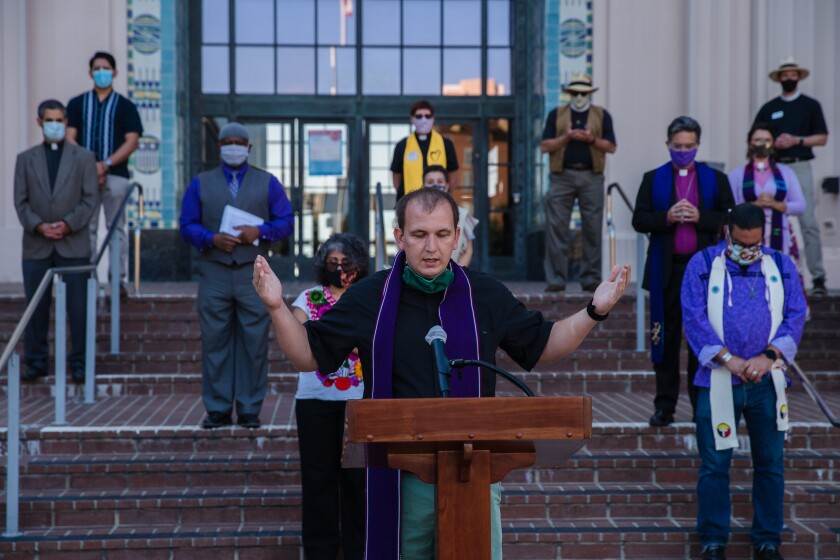 Leaders of various faiths prayed with the Rev. Marcus Lohrmann at the San Diego County Administration Building in 2020.