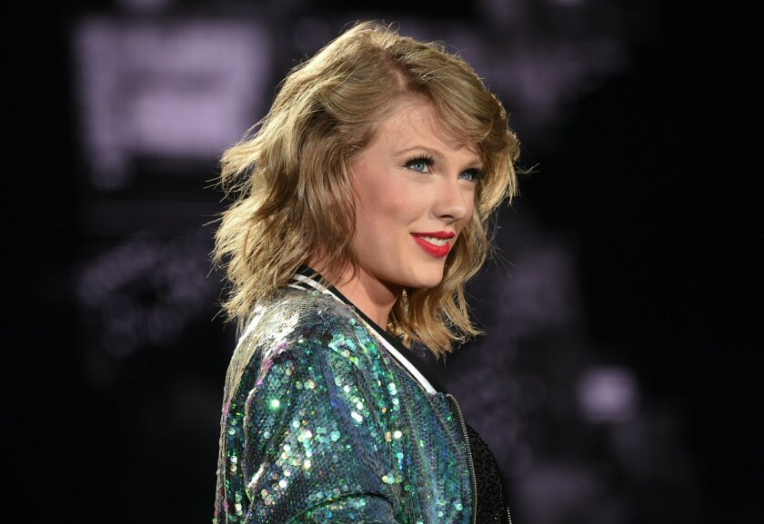 """FILE - In this Friday, July 10, 2015 file photo, singer Taylor Swift performs during her """"1989"""" world tour at MetLife Stadium in East Rutherford in New Jersey. Swift and Nicki Minaj traded words on Twitter after the rapper said she was upset she didn't earn a nomination for video of the year at the"""