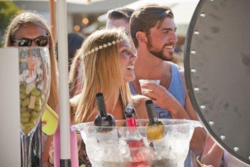 Last year's La Jolla Art and Wine Festival attendees enjoy wine tasting. Courtesy