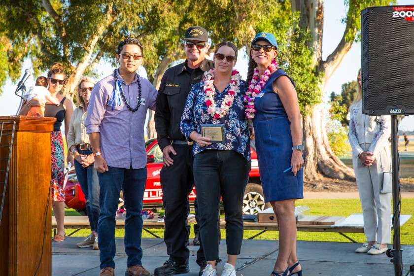Elvin Lai, co-emcee, Lifeguard Chief James Gartland, PAESAN honoree Lifeguard Alison Knight and co-emcee Marcella Bothwell.
