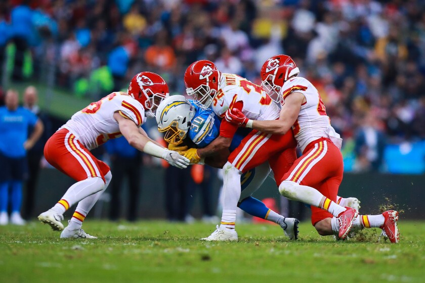 Chiefs safety Tyrann Mathieu tackles Chargers running back Austin Ekeler during the second half of a game Nov. 18 at Estadio Azteca.