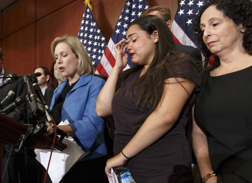 Anna, center, a victim of sexual assault at college, with her mother Susan, right, joins Sen. Kirsten Gillibrand (D-N.Y.) at a news conference on Capitol Hill in Washington to discuss the Campus Accountability and Safety Act.