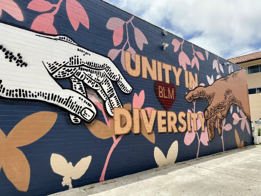 "The new ""Unity in Diversity"" mural covers a wall of CJ Charles Jewelers at 1135 Prospect St. in La Jolla."