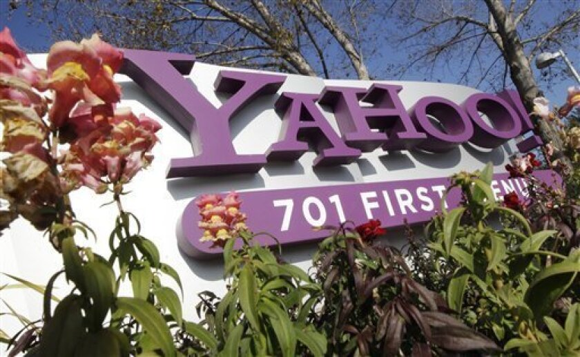 FILE - In this Jan. 4, 2012 file photo, the company logo is displayed at Yahoo headquarters in Sunnyvale, Calif. Yahoo Inc. on Wednesday, April 4, 2012 announced that the company is laying off 2,000 employees as new CEO Scott Thompson sweeps out jobs that don't fit into his plans for turning around the beleaguered Internet company. The cuts announced Wednesday represent about 14 percent of the 14,100 workers employed by Yahoo. (AP Photo/Paul Sakuma, File)