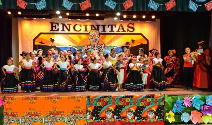 Ballet Folklorico de San Dieguito and Ballet Folklorico el Tapatio with director Nadia Arumbula at the 2018 Encinitas Dia de los Muertos. This year's event, put on by the City of Encinitas and the Encinitas Friends of the Arts, takes place Oct. 26 at the Encinitas Community Center.
