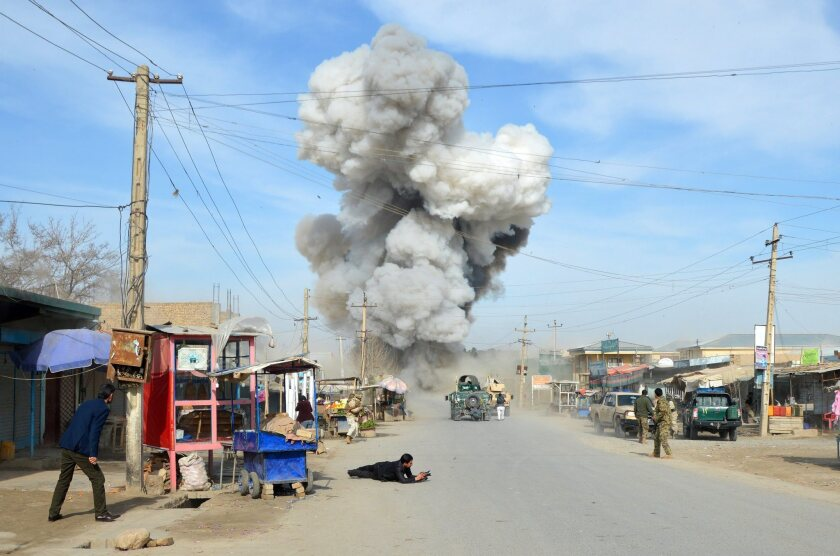Smoke billows from the scene of a suicide bomb blast that targeted a police headquarters in Kunduz, Afghanistan, on Feb. 10, 2015.