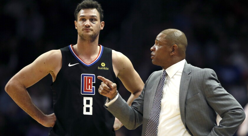 Los Angeles Clippers head coach Doc Rivers talks with forward Danilo Gallinari during the second hal