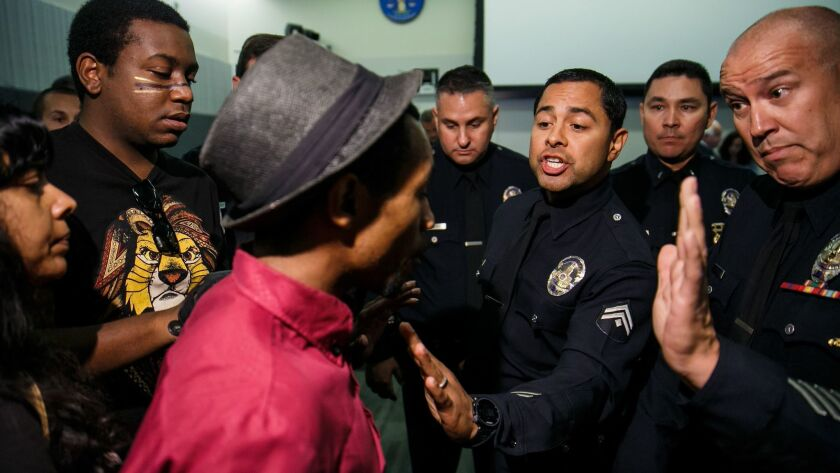 Protesters interrupt a Los Angeles Police Commission meeting.