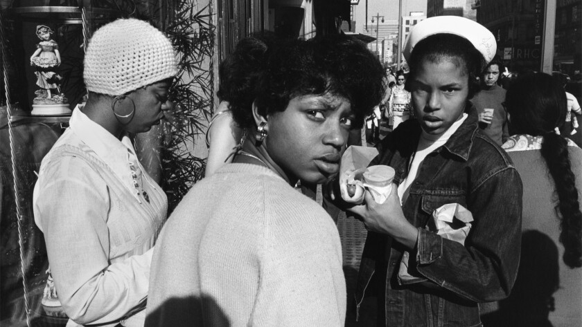 """In """"Los Angeles #14,"""" from 1973, a group of young women stare warily at Hernandez's camera."""