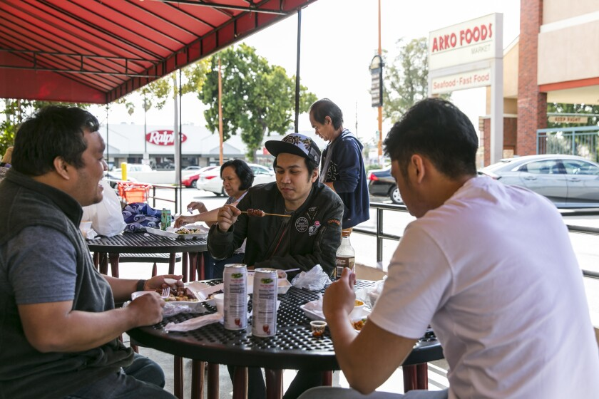 Customers enjoy a lunch on the patio at Arko Foods International.