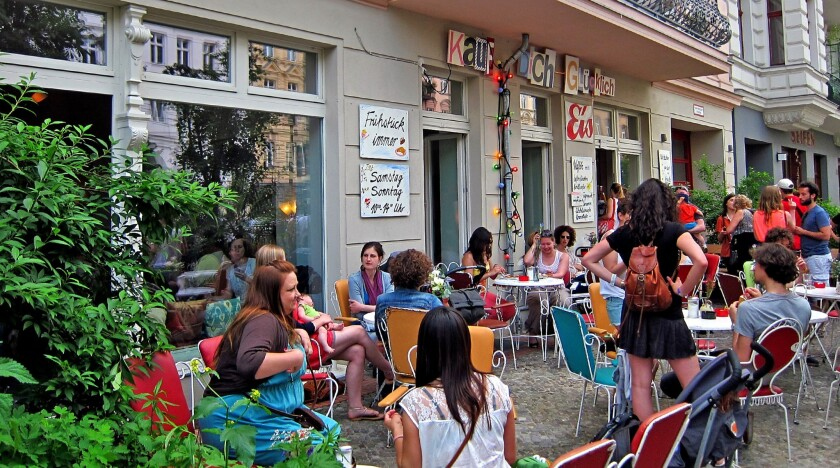 It's a lively patio in front of Kauf Dich Glucklich waffle house, a much recommended spot in Berlin.
