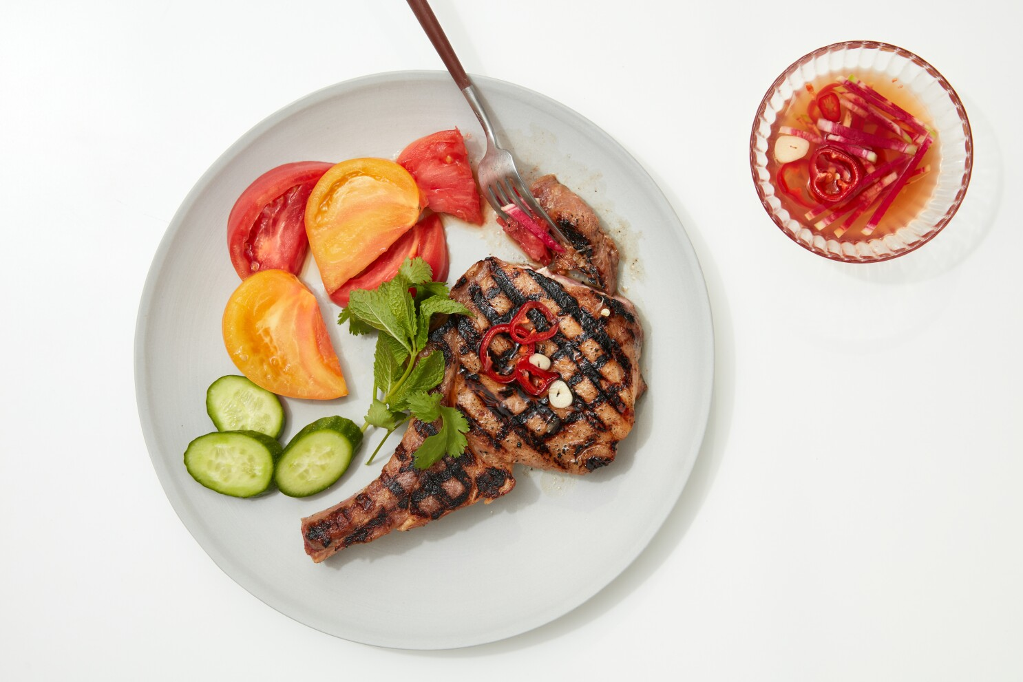 Vietnamese grilled pork chops with watermelon radish nuoc cham