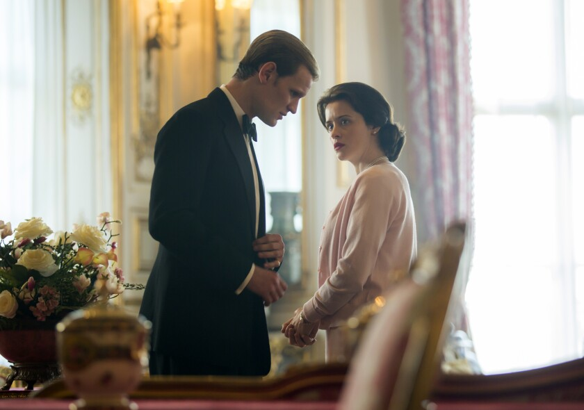 "Claire Foy as Queen Elizabeth II and Matt Smith as Prince Philip in a scene from ""The Crown."""