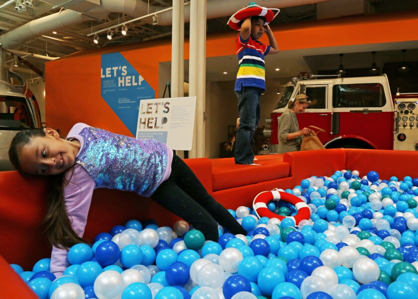 Hayley Alvarez, 7, and Nicholas Valladares, 6, play together in the ball pit at Cayton Children's Museum by ShareWell in Santa Monica.