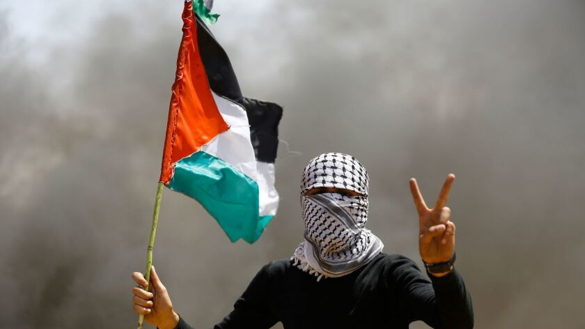 A Palestinian demonstrator during a protest April 6 on the Gaza-Israel border, east of Gaza City.
