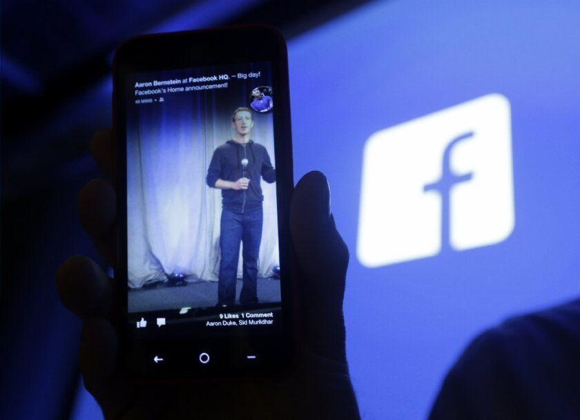 A presentation by Facebook CEO Mark Zuckerberg is displayed on a smartphone.