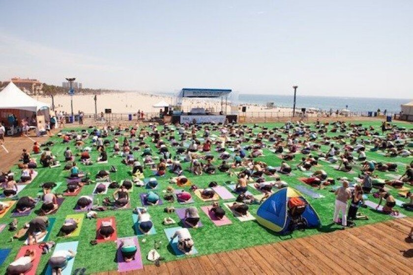 Wanderlust sponsors a free Yoga in the City half-day event at the Santa Monica Pier on June 30.