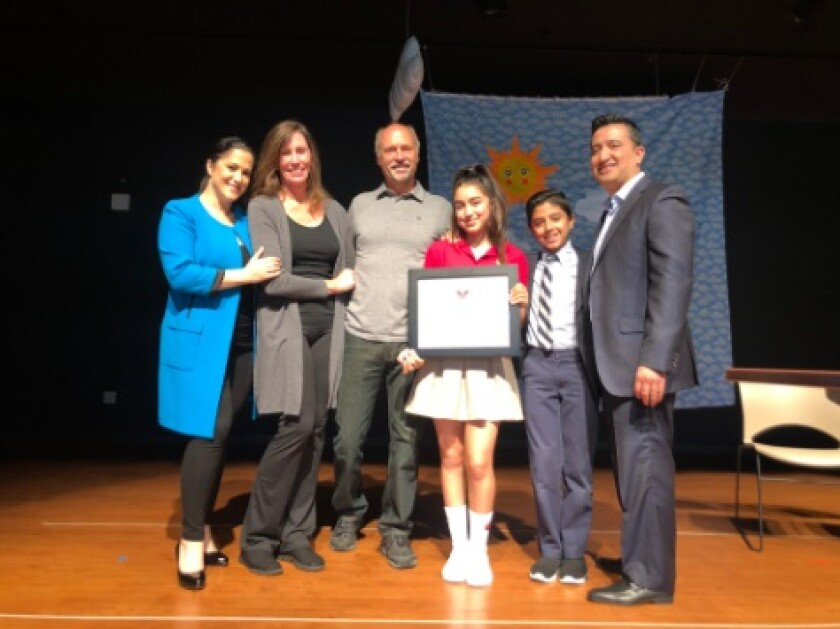GG Benitez, Build a Miracle founders Julianne and Chris North, Daniella Benitez, Gabriel Benitez, Daniel Benitez at Notre Dame Academy's Assembly
