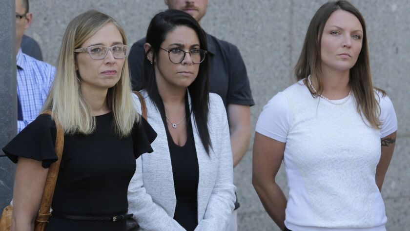 Annie Farmer, left, and Courtney Wild, right, accusers of Jeffrey Epstein, stand outside the courthouse in New York on Monday.
