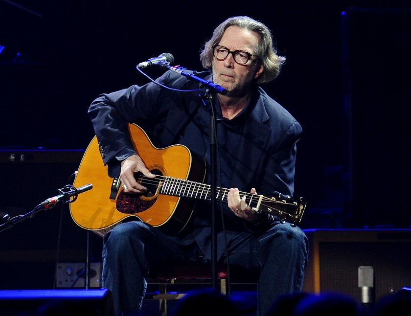 """FILE - In this Feb. 18, 2010 file photo, Eric Clapton performs in concert at Madison Square Garden in New York. Clapton is paying tribute to his late friend and collaborator J.J. Cale with a new album. Tom Petty, Willie Nelson, John Mayer and others lend a hand on """"The Breeze: An Appreciation of J.J. Cale,"""" due out July 29. The album includes 16 Cale songs reimagined by Clapton and the all-star group of friends. Cale, architect of the Tulsa Sound and a widely influential figure in rock 'n' roll history, died last year at 74. (AP Photo/Evan Agostini)"""