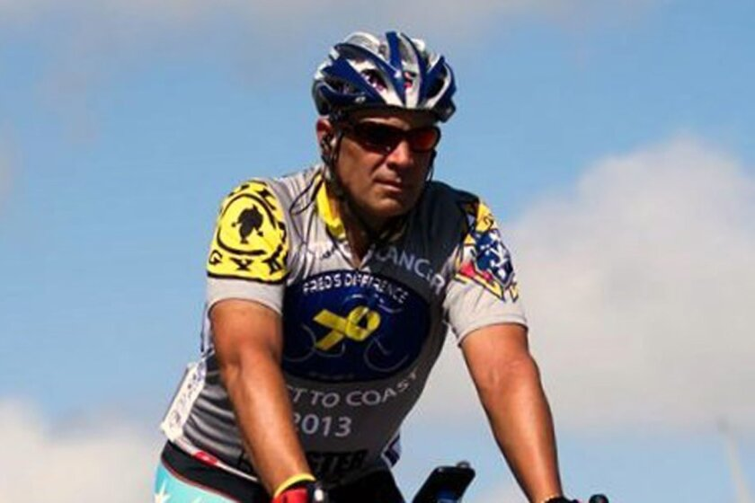 Fred Vlchek pedals across Kansas as part of his 3,200-mile ride that will end Sunday.
