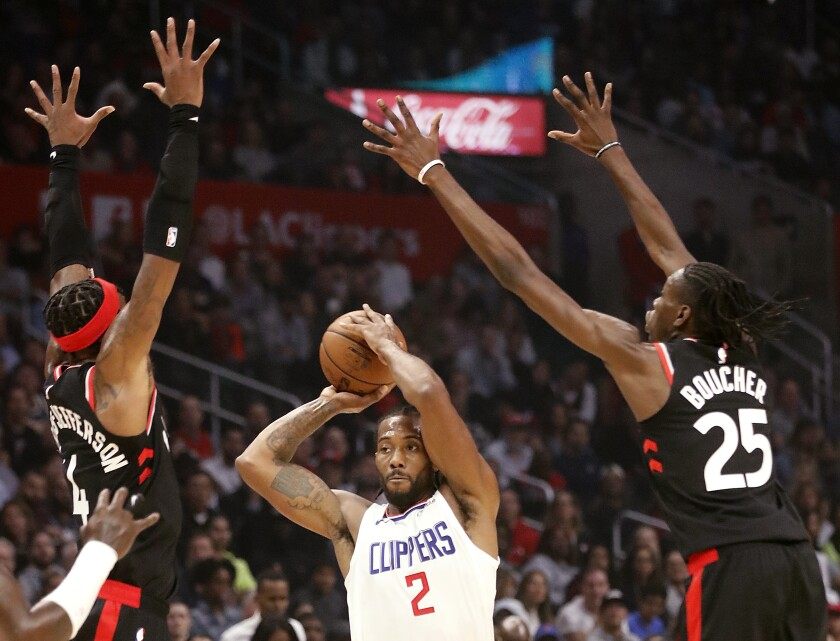 Clippers forward Kawhi Leonard look for a passing lane during a game Nov. 11 against the Raptors at Staples Center.
