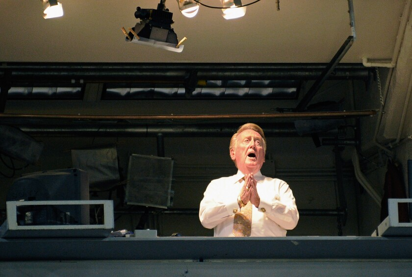 "Vin Scully sings ""Take me out to the ballgame"" during a game between the Dodgers and Arizona Diamondbaclks at Dodger Stadium in September 2011."